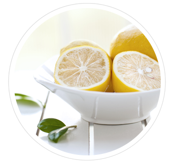 Lemons in an elegant ceramic bowl.